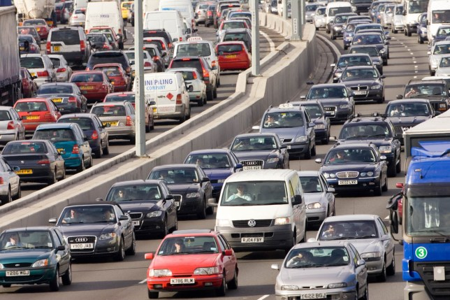 Commuters face paying ?1,000 to drive to work LONDON, ENGLAND - JUNE 21: Traffic congestion of cars and vans in both directions on M25 motorway, near London, United Kingdom (Photo by Tim Graham/Getty Images)