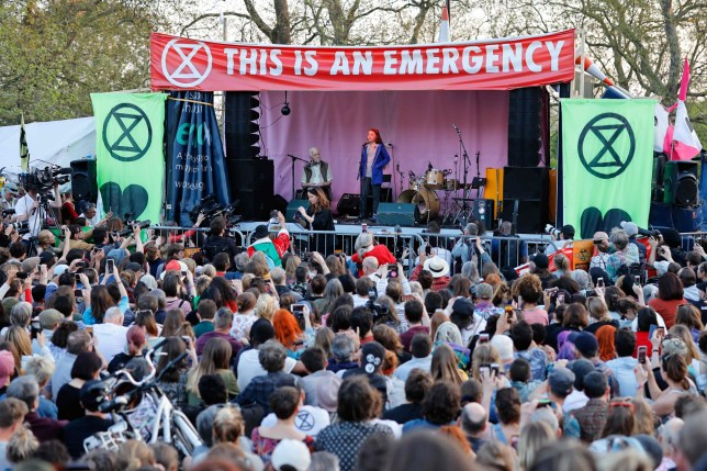 Swedish climate change activist Greta Thunberg (C) speaks at the Extinction Rebellion group's environmental protest camp at Marble Arch in London on April 21, 2019, on the seventh day of the group's protest calling for political change to combat climate change. - Climate change protesters who have brought parts of London to a standstill said Sunday they were prepared to call a halt if the British government will discuss their demands. Some 831 arrests have been made and 42 people charged in connection with the ongoing Extinction Rebellion protests. On the seventh day of demonstrations that have occupied key spots in the British capital, organisers said they were willing to switch tactics from disruption to dialogue. (Photo by Tolga Akmen / AFP)TOLGA AKMEN/AFP/Getty Images