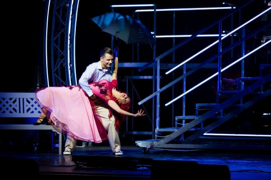"""MANCHESTER, ENGLAND - MAY 03: Pasha Kovalev and Dianne Buswell perform on stage during """"The Strictly Professionals Tour"""" final dress rehearsal at The Lowry on May 3, 2019 in Manchester, England.. (Photo by Dave J Hogan/Getty Images for Phil McIntyre Productions)"""