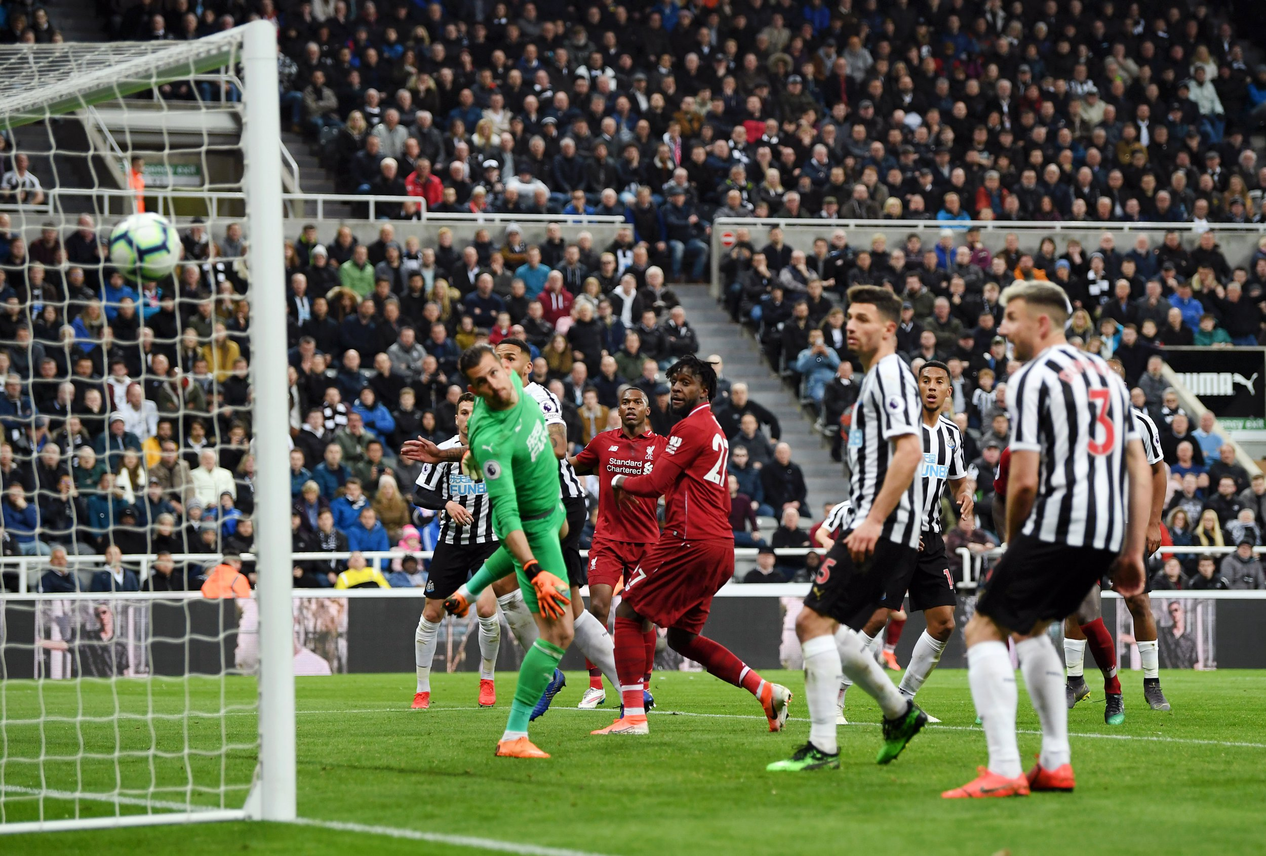 Liverpool keep Premier League title dream alive with dramatic late Newcastle win