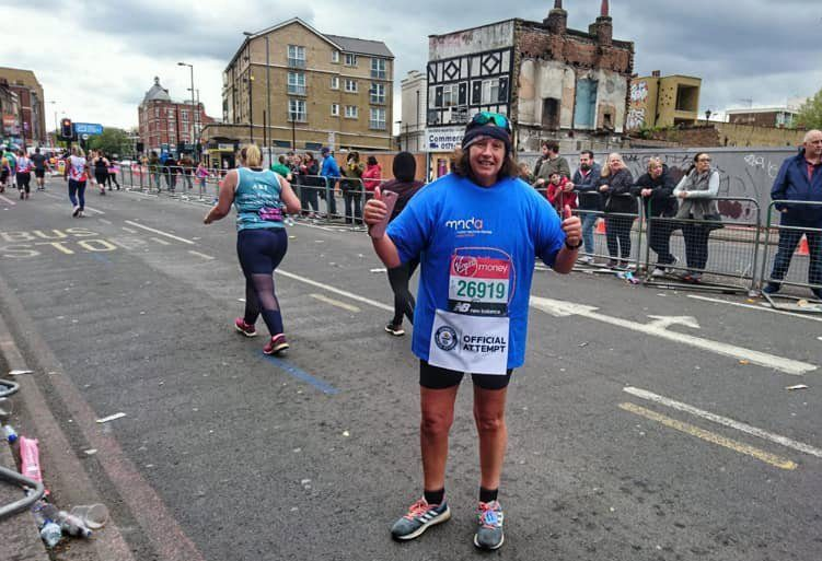 Samantha Morris ran the London Marathon while wearing 46 t-shirts in a world record attempt (Picture: MND Association)