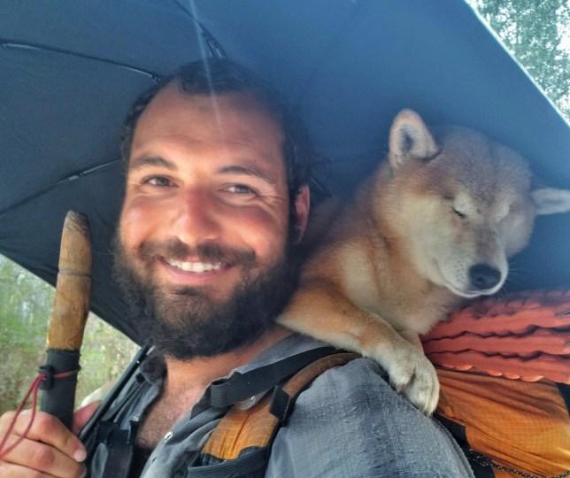 Kyle carrying Katana under an umbrella