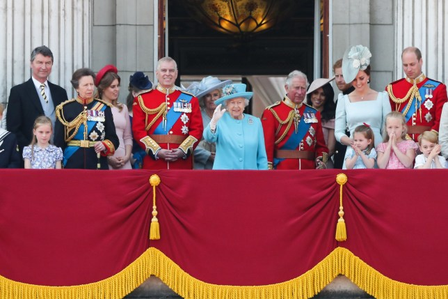 The Queen surrounded by the royal family on the balcony of Buckingham Palace
