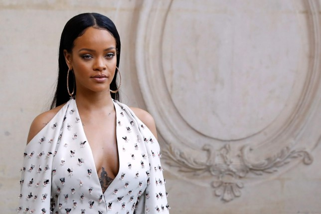 Rihanna poses before the Christian Dior 2017 Spring/Summer show in Paris