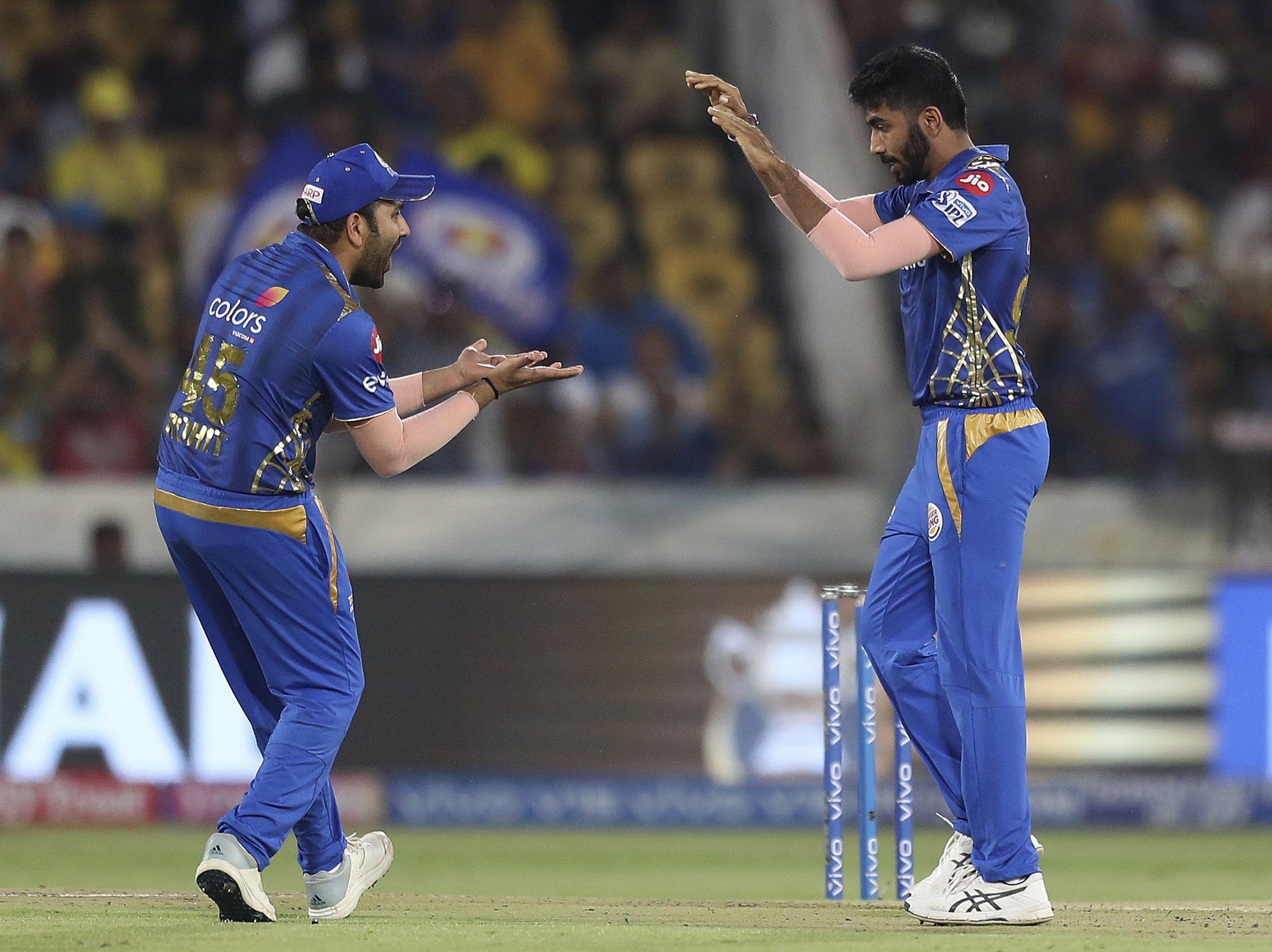 Mumbai Indians Jasprit Bumrah, right, celebrates with captain Rohit Sharma after the dismissal of Chennai Super King's Ambati Rayudu during the VIVO IPL T20 cricket final match in Hyderabad, India, Sunday, May 12, 2019. (AP Photo/ Mahesh Kumar A.)