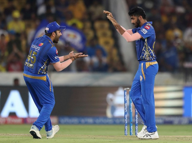 Mumbai Indians Jasprit Bumrah, right, celebrates with captain Rohit Sharma after the dismissal of Chennai Super King's Ambati Rayudu during the VIVO IPL T20 cricket final match in Hyderabad, India, Sunday, May 12, 2019. (AP Photo/ Mahesh Kumar A.)