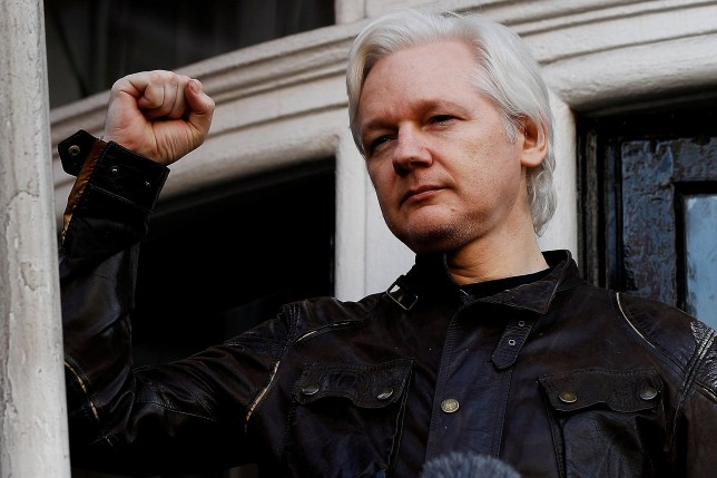 FILE PHOTO: WikiLeaks founder Julian Assange is seen on the balcony of the Ecuadorian Embassy in London, Britain May 19, 2017. REUTERS/Peter Nicholls/File Photo