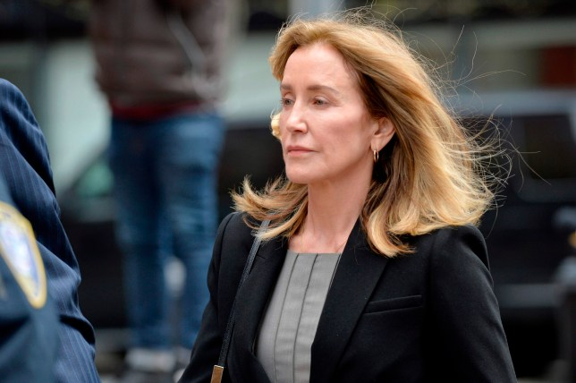Actress Felicity Huffman is escorted by Police into court where she is expected to plead guilty to one count of conspiracy to commit mail fraud and honest services mail fraud before Judge Talwani at John Joseph Moakley United States Courthouse in Boston, Massachusetts, May 13, 2019. (Photo by Joseph Prezioso / AFP)JOSEPH PREZIOSO/AFP/Getty Images