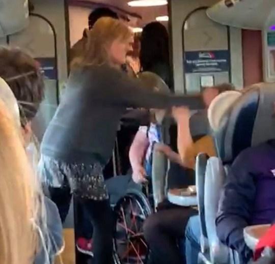 The woman slaps a female passenger