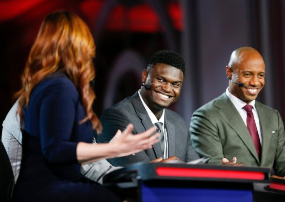 Dukes' Zion Williamson second from right, is interviewed by an ESPN reporter during the NBA basketball draft lottery Tuesday, May 14, 2019, in Chicago. (AP Photo/Nuccio DiNuzzo)