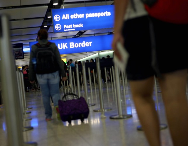 """General view of passengers going through UK Border at Terminal 2 of Heathrow Airport, as a Border Force official has said that identifying victims of female genital mutilation (FGM) is like """"looking for the needle in the haystack""""."""