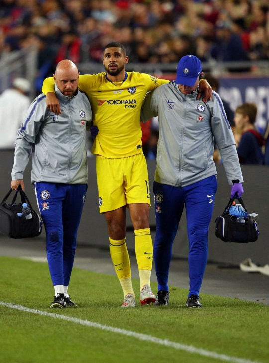 Chelsea's Ruben Loftus-Cheek, center, is helped off the field by training staff following an injury during the second half of a friendly soccer match against the New England Revolution, Wednesday, May 15, 2019, in Foxborough, Mass. (AP Photo/Stew Milne)