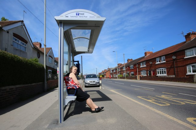 Pat Woodhouse 67 of Maltby shares her disgust at a new ?6000 bus stop that isn't even used, May 15 2019. See story SWLEshelter: Shambolic council bosses have spent nearly ?6,000 on a new bus shelter - down a road that's not even served by public transport. Residents were bemused when they noticed a rusty old pole being replaced by a brand new bus stop complete with a roof and seats. Red-faced council officials claim they were unaware bus routes changed earlier this year and have now apologised for the gaffe. Locals in Rotherham, South Yorks, have slammed the council for wasting thousands of pounds that could have been spent elsewhere.