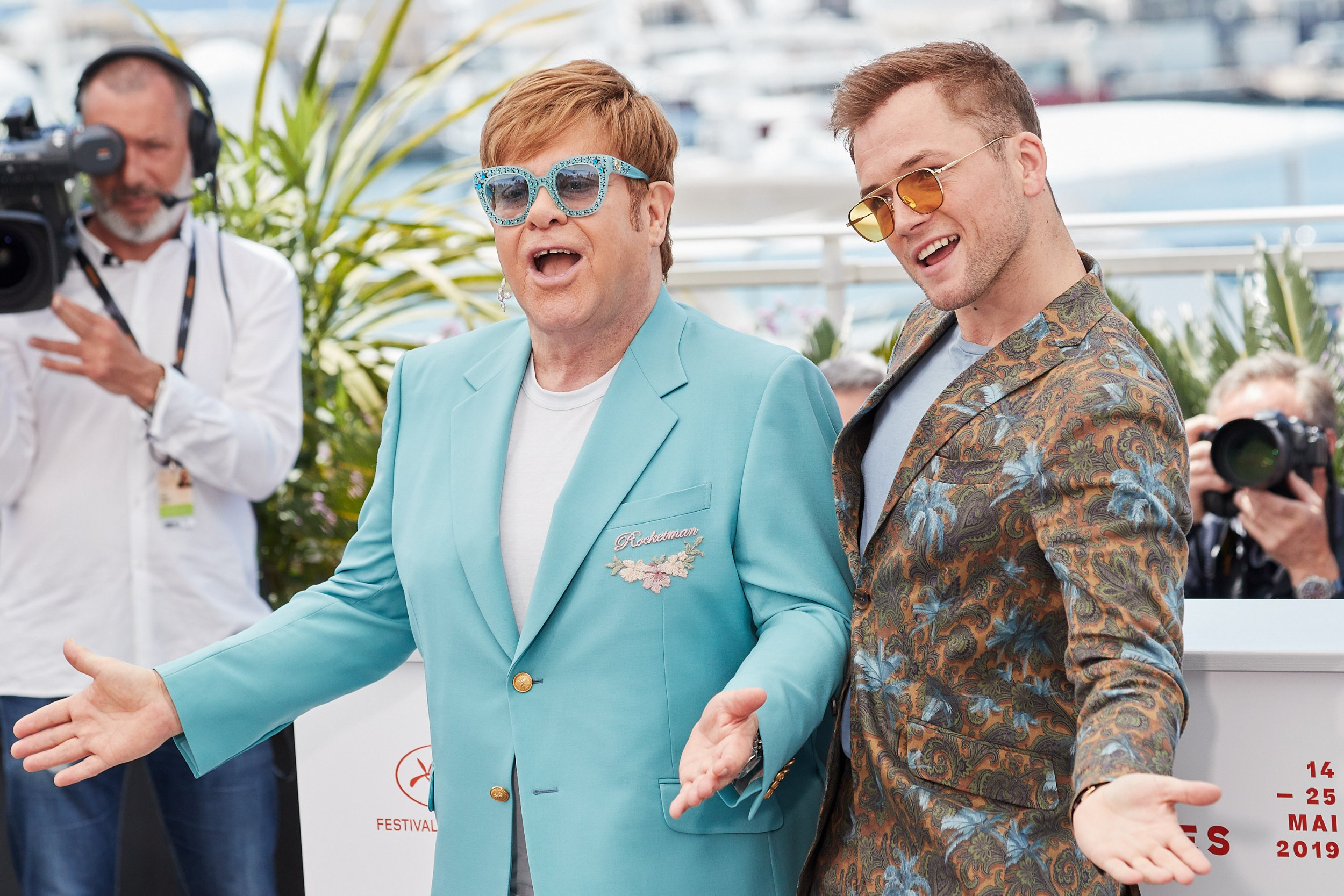 Sir Elton John and Taron Egerton attend a photocall for Rocketman during a 72nd annual Cannes Film Festival