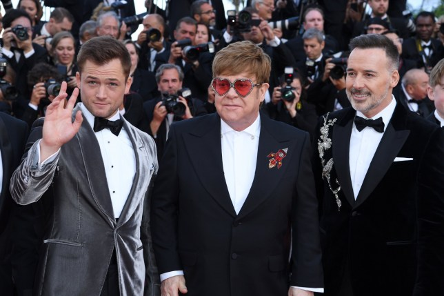 Taron Egerton, Sir Elton John and David Furnish attending the Rocketman premiere, held at the Grand Theatre Lumiere during the 72nd Cannes Film Festival. Photo credit should read: Doug Peters/EMPICS