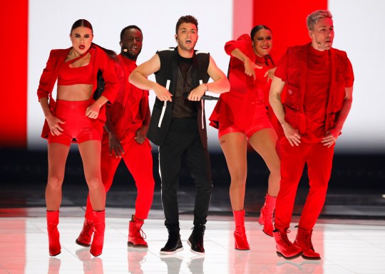 "Luca Hanni of Switzerland performs the song 'She Got Me"" during the 2019 Eurovision Song Contest grand final in Tel Aviv, Israel, Saturday, May 18, 2019. (AP Photo/Sebastian Scheiner)"