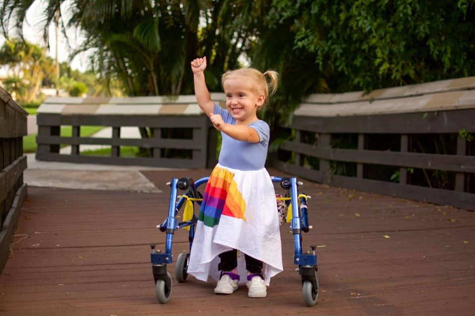 Two-year-old with spina bifida doesn't let her condition stop her enjoying life