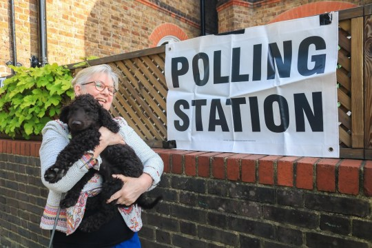 Alamy Live News. TA9JJA Wimbledon London, UK. 23rd May, 2019. A woman walks her dog to the polling station in Wimbledon to vote at the European Parliament Elections. It is forecast the Brexit Party of Nigel Farage is expected to do well at the expense of Labour and Conservative Parties Credit: amer ghazzal/Alamy Live News This is an Alamy Live News image and may not be part of your current Alamy deal . If you are unsure, please contact our sales team to check.