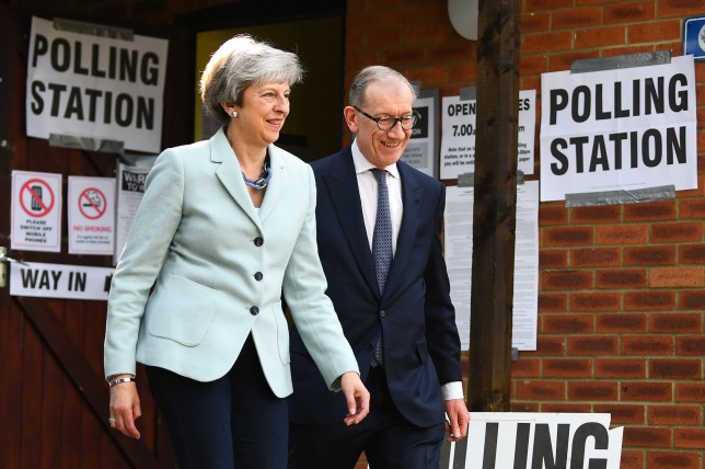 Prime Minister Theresa May and her husband, Philip, after casting their votes at a polling station near her Maidenhead constituency as voters head to the polls for the European Parliament election. PRESS ASSOCIATION Photo. Picture date: Thursday May 23, 2019. See PA story POLITICS Election. Photo credit should read: Victoria Jones/PA Wire
