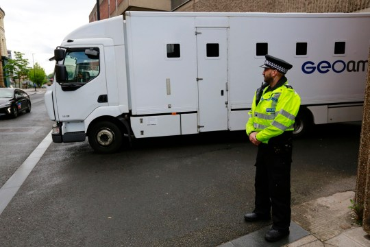 A prison van arrives at Sheffield Magistrates Court, protected by police, Monday May 27 2019. A man and woman arrested on Friday 24 May at an address in Shiregreen have now each been charged with two counts of murder. The woman has also been charged with three counts of attempted murder.