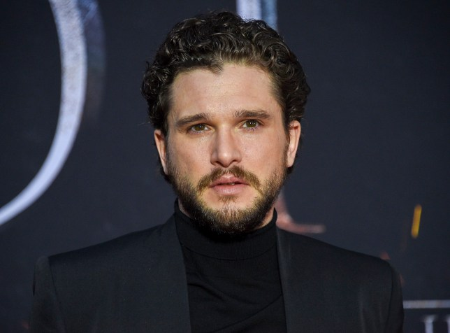 kit harington, who played jon snow on game of thrones wearing a black t shirt and jacket