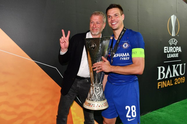 Chelsea owner Roman Abramovich and Cesar Azpilicueta celebrate with the Europa League trophy