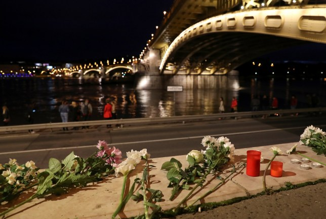 Flowers are placed near the site of a ship accident, which killed several people, on the Danube river in Budapest, Hungary, May 30, 2019. REUTERS/Marko Djurica