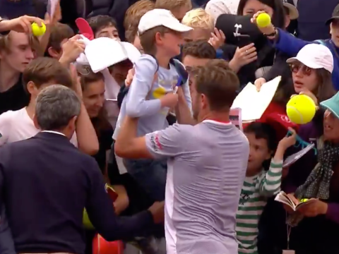 Stan Wawrinka pulls distressed young fan out of the crowd as he shows caring side