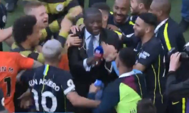 Yaya Toure was mobbed by Manchester City players after the win