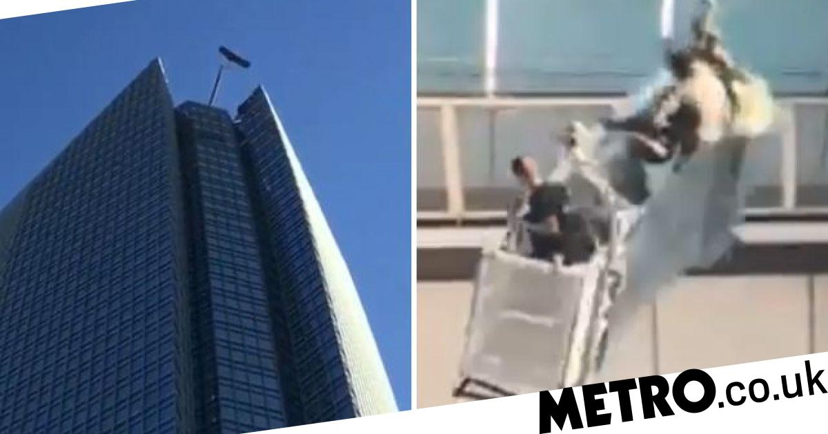 Lift carrying window cleaners swings out of control atop 50