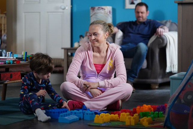 Linda and Mick Carter with Ollie in EastEnders