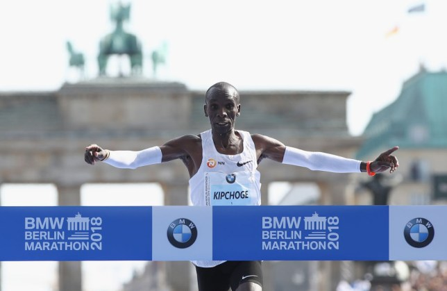 BERLIN, GERMANY - SEPTEMBER 16: Eliud Kipchoge of Kenya crosses the finishing line to win the Berlin Marathon 2018 in a new world record time of 2:01:40 hours (later officially annouced by organisers to be 2:01:39) on September 16, 2018 in Berlin, Germany. (Photo by Maja Hitij/Bongarts/Getty Images)