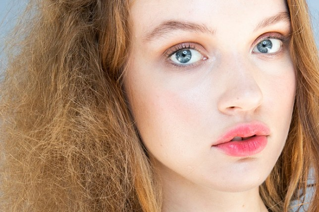 A model with hair styled to look frizzy