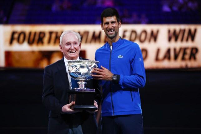 Rod Laver holds the Australian Open trophy with Novak Djokovic