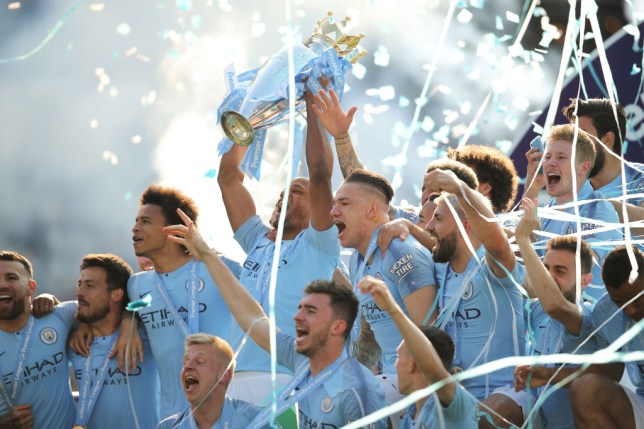 Manchester City players lifting the the Premier League trophy on the final day of the 2018/19 season