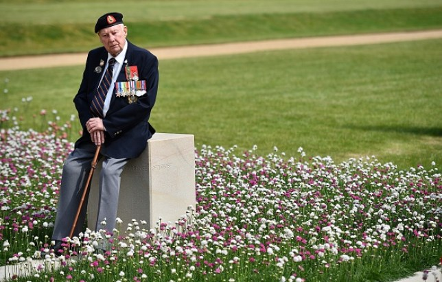 A veteran sitting in a Chelsea Flower Show garden that remembers D-Day Nomrnady landings