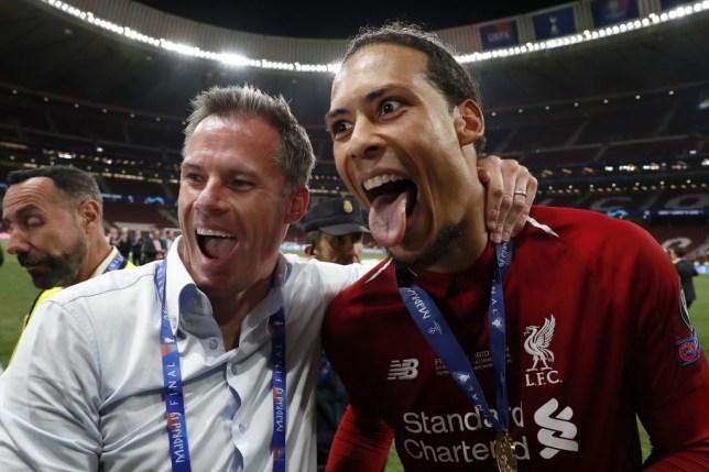 Jamie Carragher celebrates Liverpool winning the Champions League with Virgil van Dijk