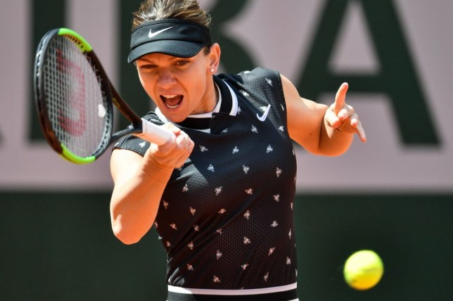 Simona Halep hits a forehand during her French Open defeat
