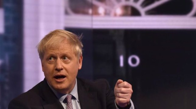 Boris Johnson with picture of No.10 in background