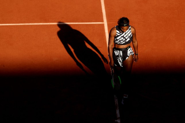 Serena Williams hangs her head and looks dejected as she crashes out of the French Open