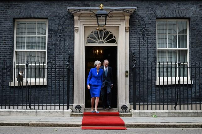 Theresa May and her husband Philip May leaving 10 Downing Street