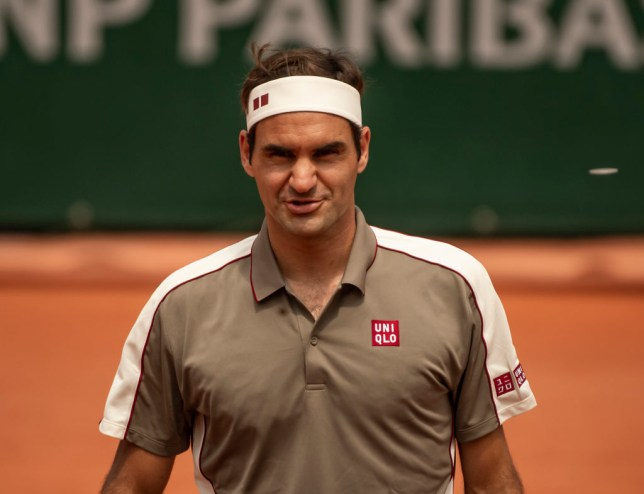Roger Federer looks on as he sets up a semi-final meeting with Rafael Nadal at the French Open