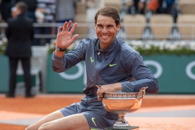 Rafael Nadal waves to the crowd after winning a 12th French Open title