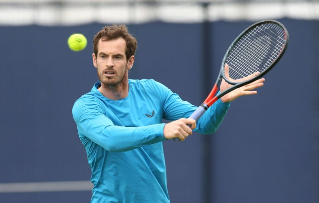 Andy Murray hits a backhand while practising at Queen's