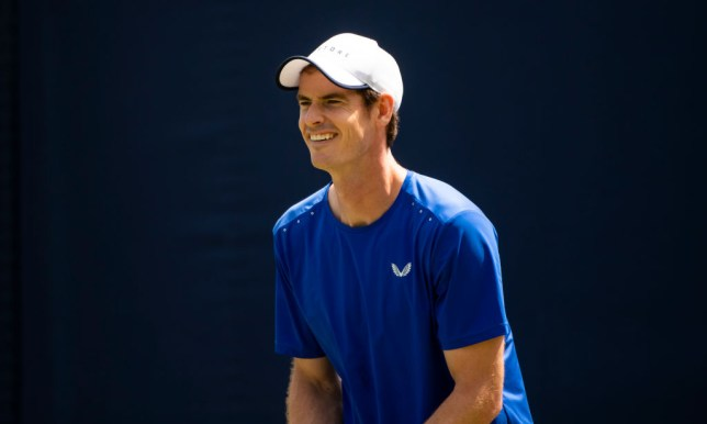 Andy Murray smiles as he practises at Queen's