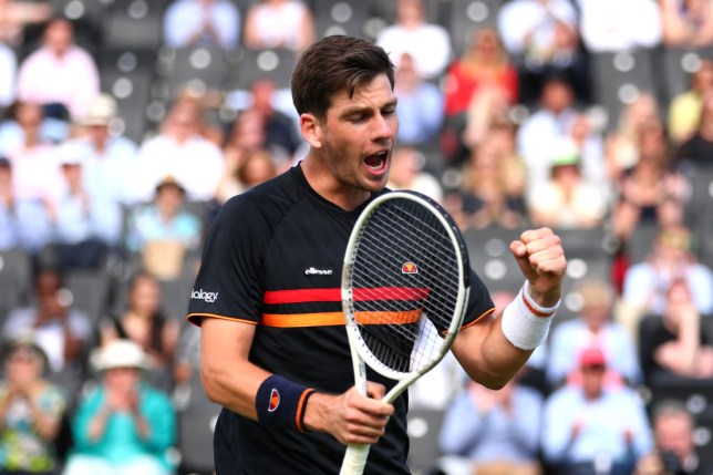 Cameron Norrie celebrates winning a point against Kevin Anderson
