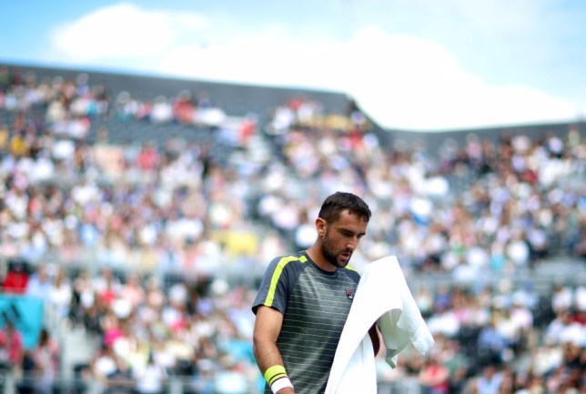 Marin Cilic looks into his towel during defeat to Diego Schwartzman at Queen's