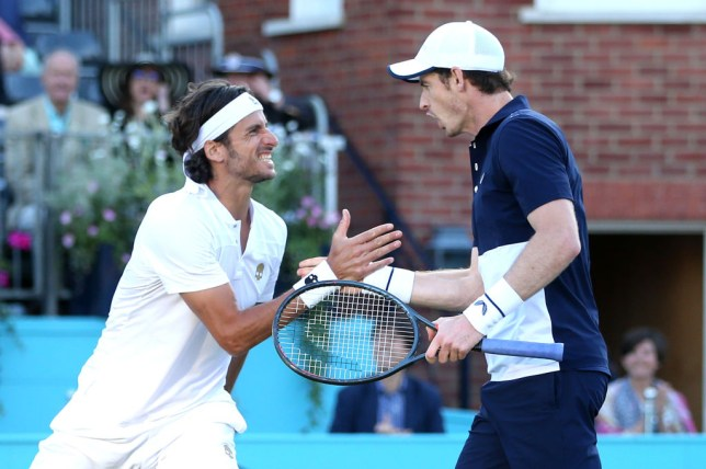 Feliciano Lopez and Andy Murray celebrate a point in the semi-finals at Queen's