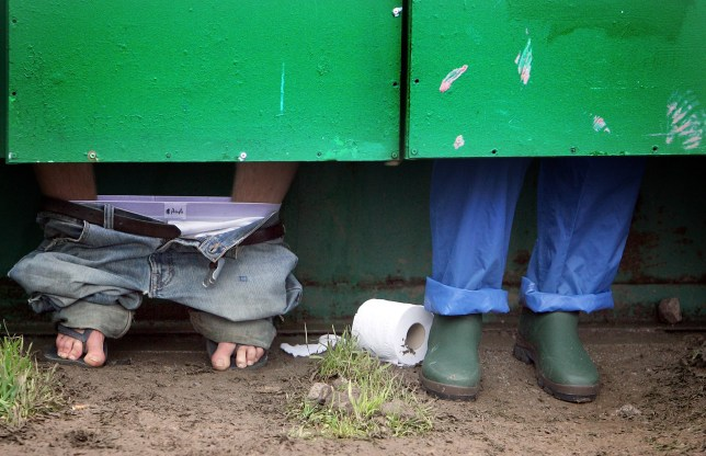 GLASTONBURY, UNITED KINGDOM - JUNE 21: Festival goers use the toilets at Worthy Farm, Pilton near Glastonbury, on June 21 2007 in Somerset, England. The festival, that was started by dairy farmer Michael Eavis in 1970, has grown into the largest music festival in Europe. This year's festival is the biggest yet and will have headline acts including The Who, The Artic Monkeys, The Killers. (Photo by Matt Cardy/Getty Images)