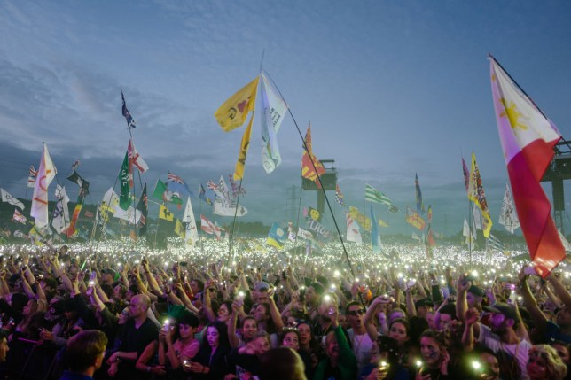 A crowd of festival-goers at Glastonbury Festival 2017 in the evening
